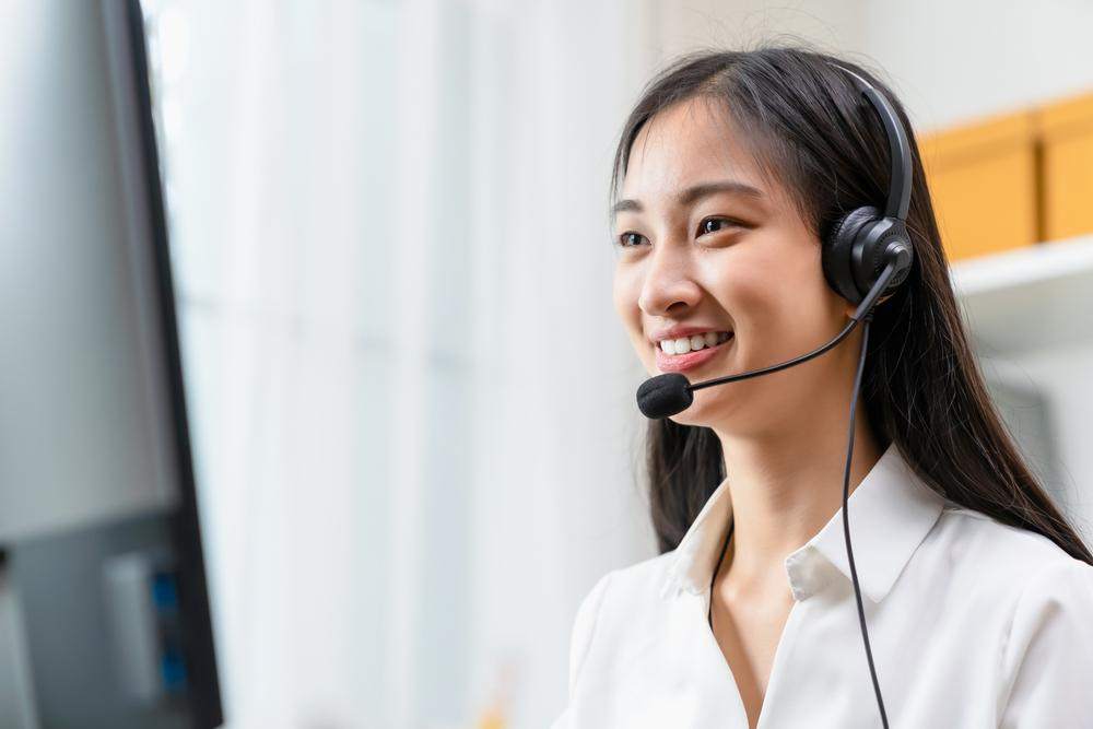 A female telemarketer talking to a client.