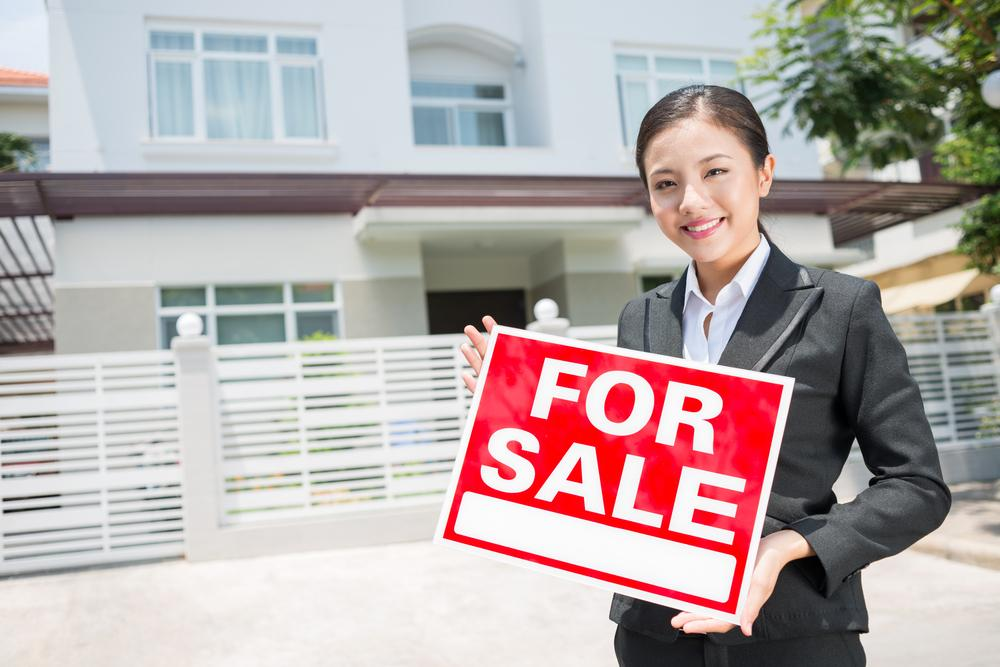 A female property agent selling a house.