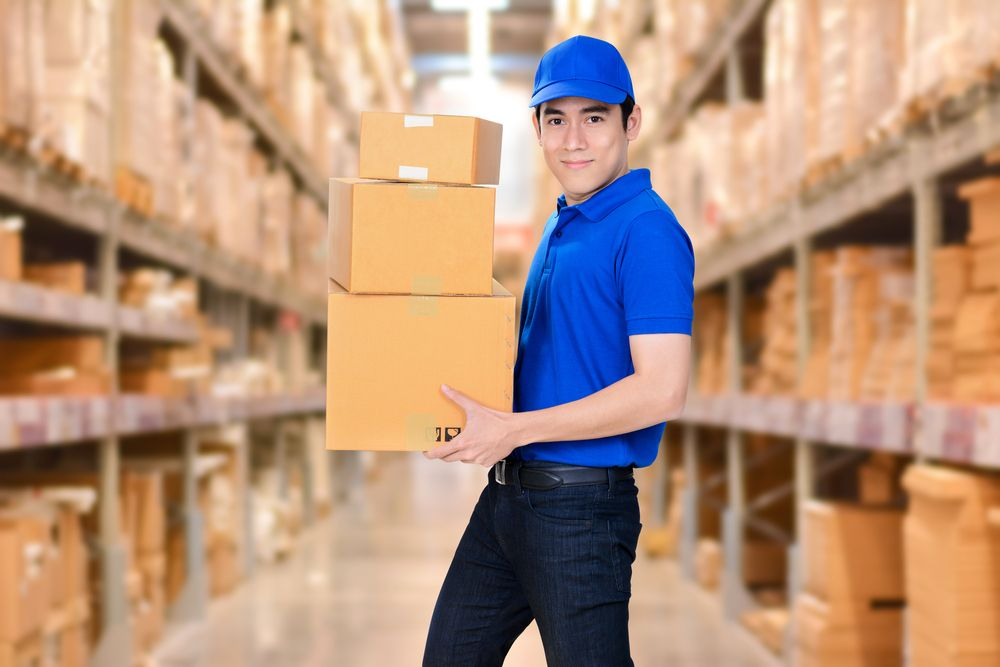 A Warehouse worker doing simple manual labour.