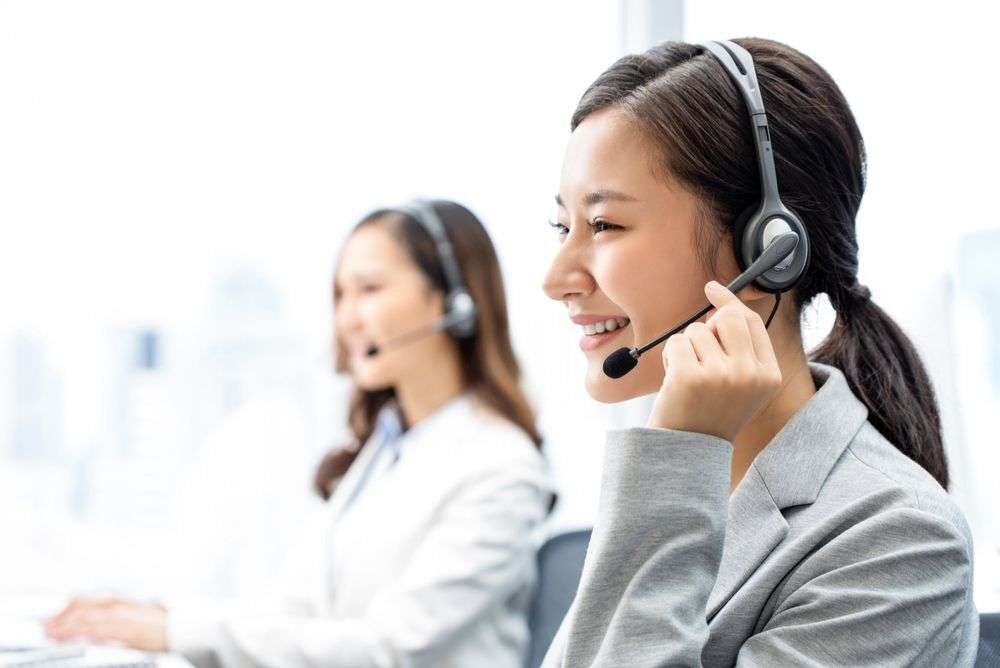 A customer service staff working in a call centre.