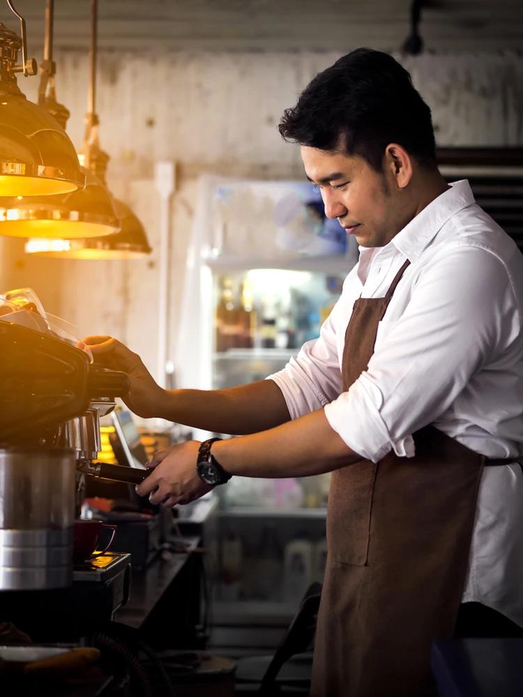A Barista working in a cafe.