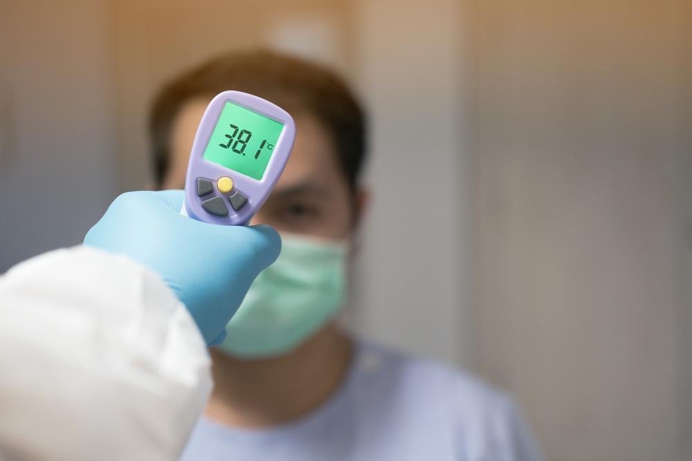 Temperature screener taker a person's temperature.
