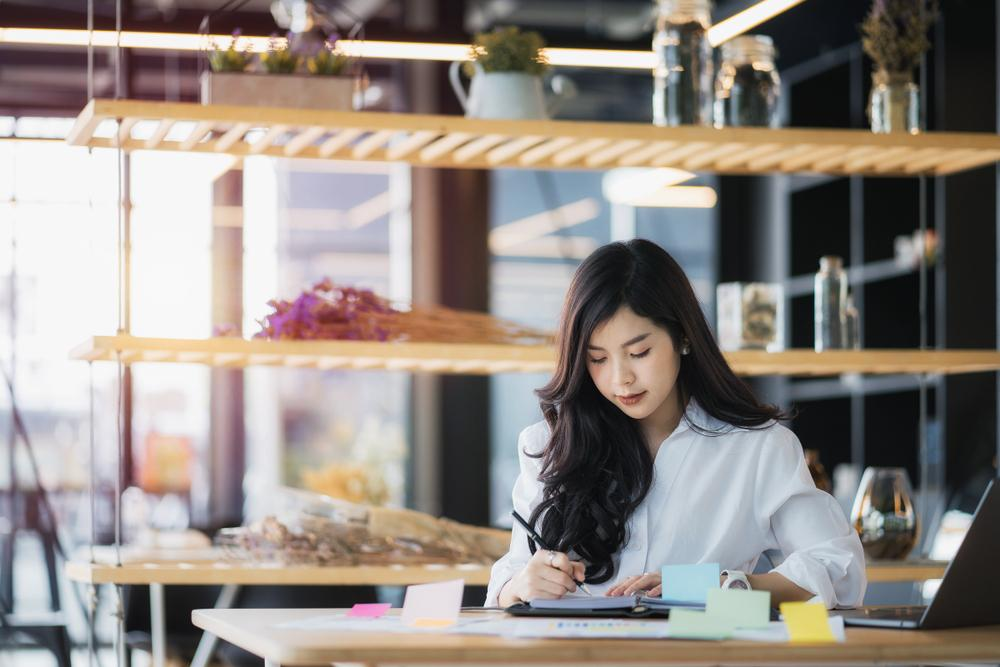 An office administrative worker doing her admin duties.