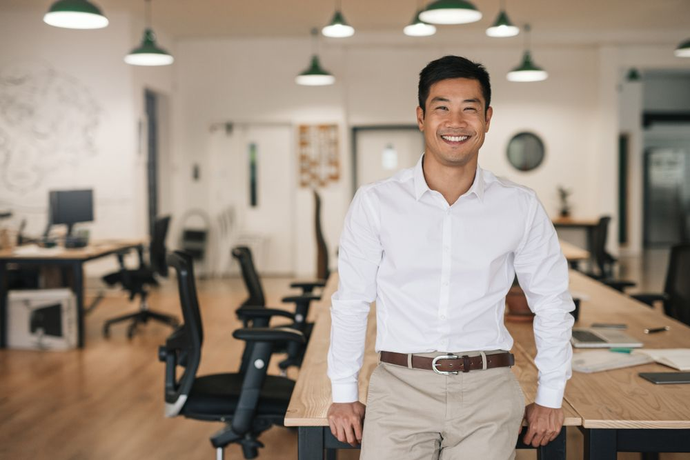 A hustler posing in an office.
