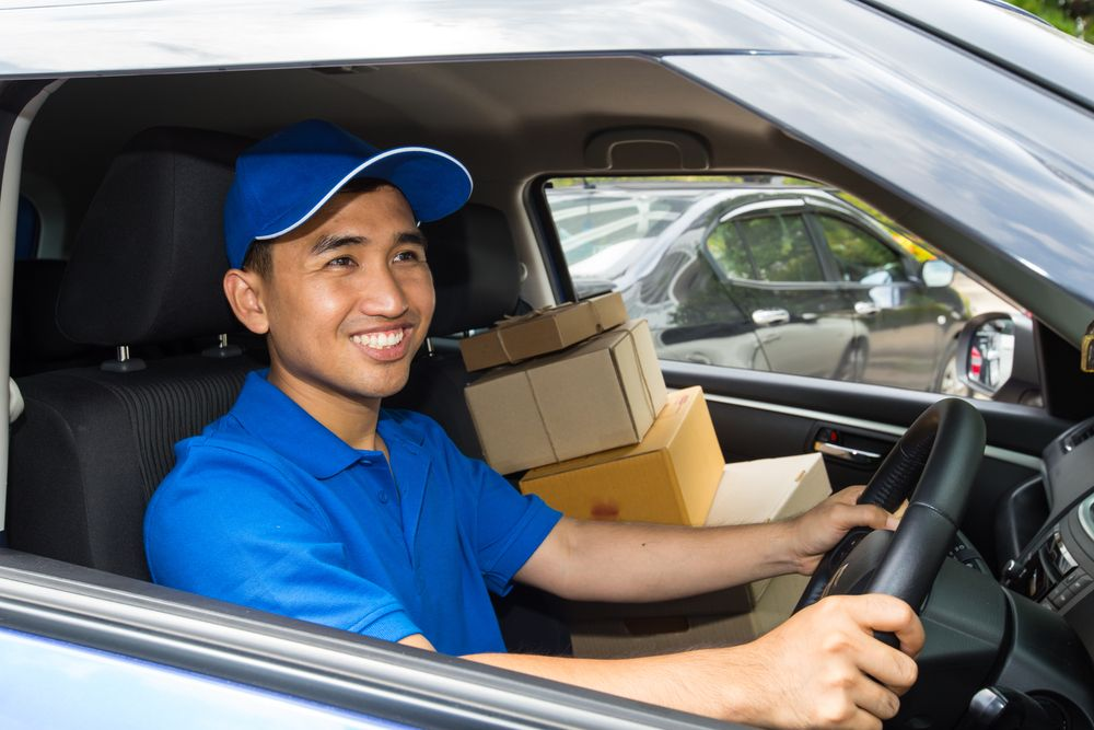 A delivery driver wearing a blue polo t shirt.