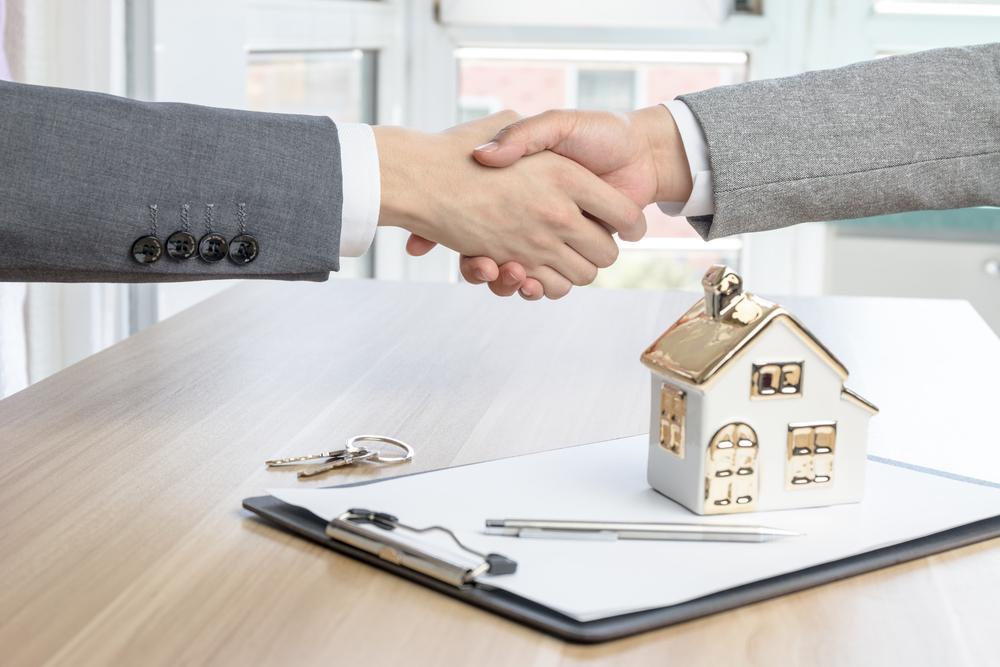 A property Agent closing a deal.