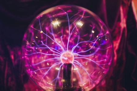 Pulsating purplish ion ball with purple magnetic bolts shooting out of it.