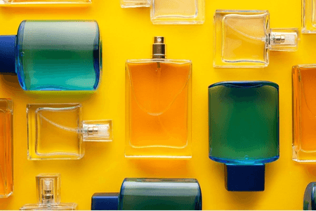 Perfumes organized against a yellow background