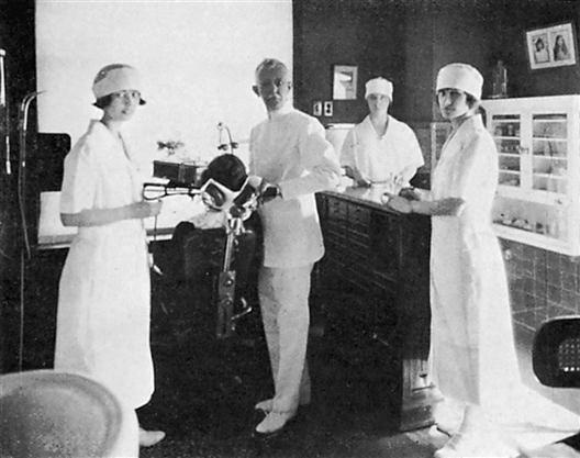 C. Edmund Kells in his dental practice