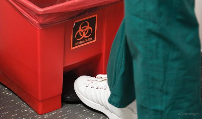 Opening a biohazard waste basket