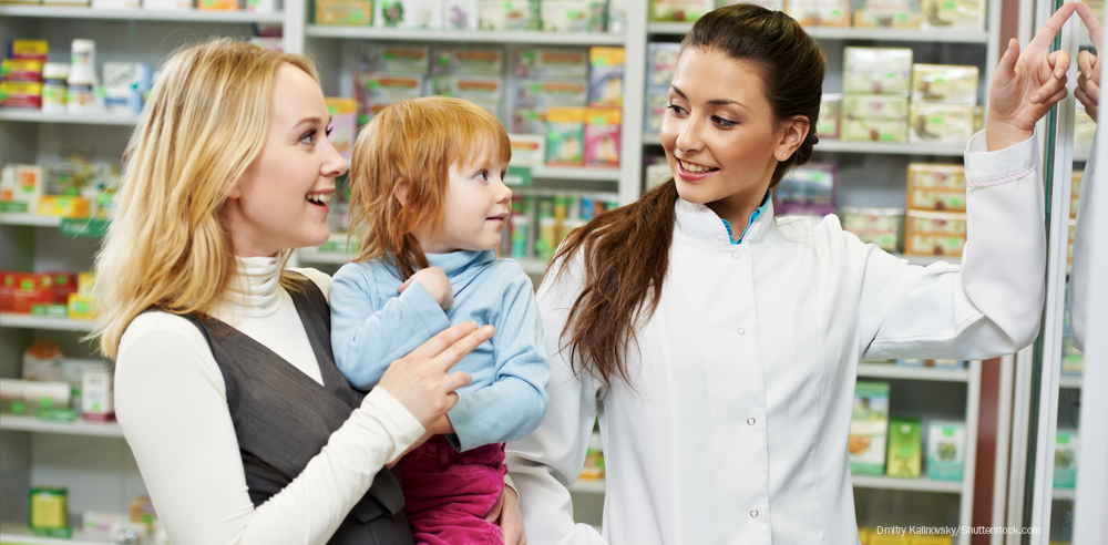 Pharmacist with child