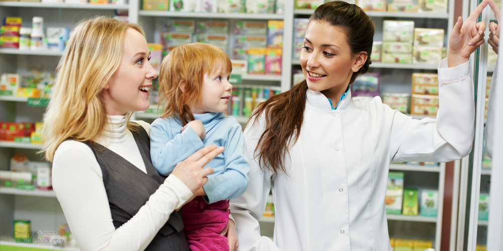 Pharmacist speaking with a child