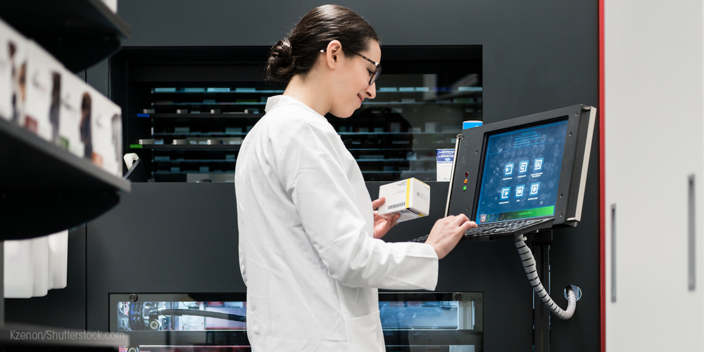 Pharmacy technician at computer station