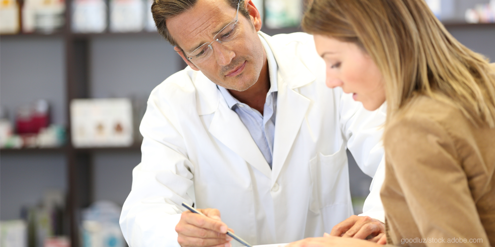 Pharmacist working with a patient