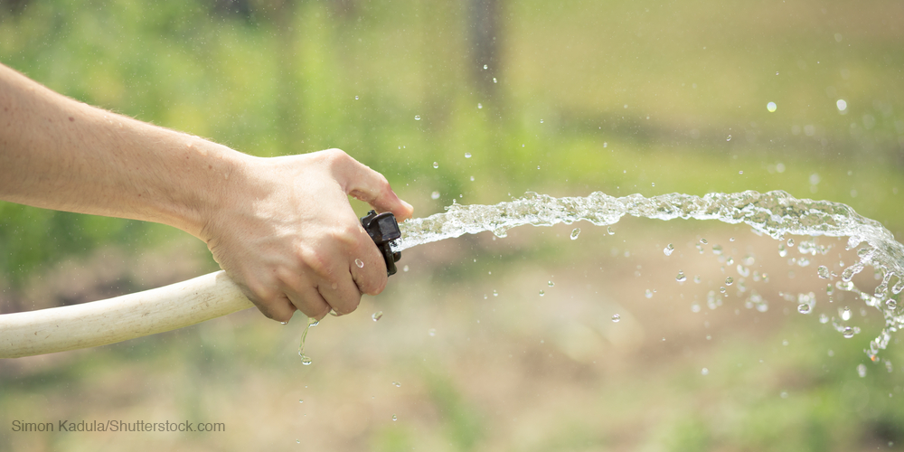 Hose spraying water as example of high blood pressure