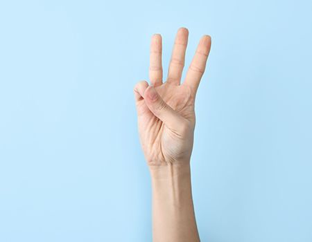 holding up three fingers