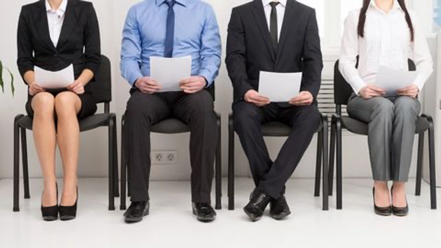 people sitting on chairs holding paper