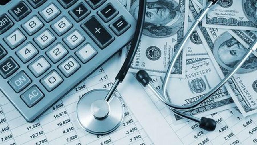 calculator money stethoscope bills