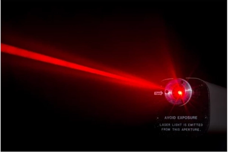 red laser darting across a black backdrop
