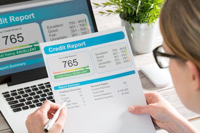 Woman looking at credit report.