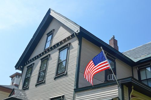 House with American flag.