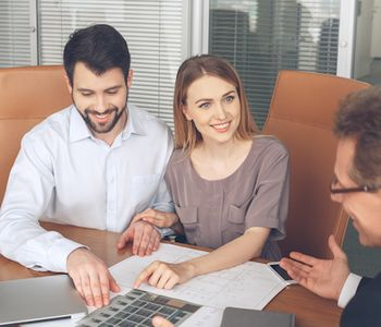 Couple talking to VA loan specialist.