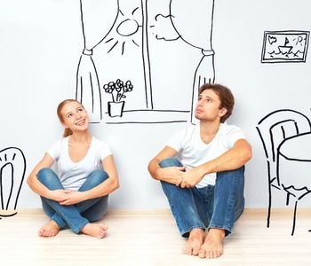 Couple thinking if now is the best time to buy a home