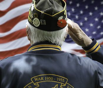 Veteran saluting to American flag