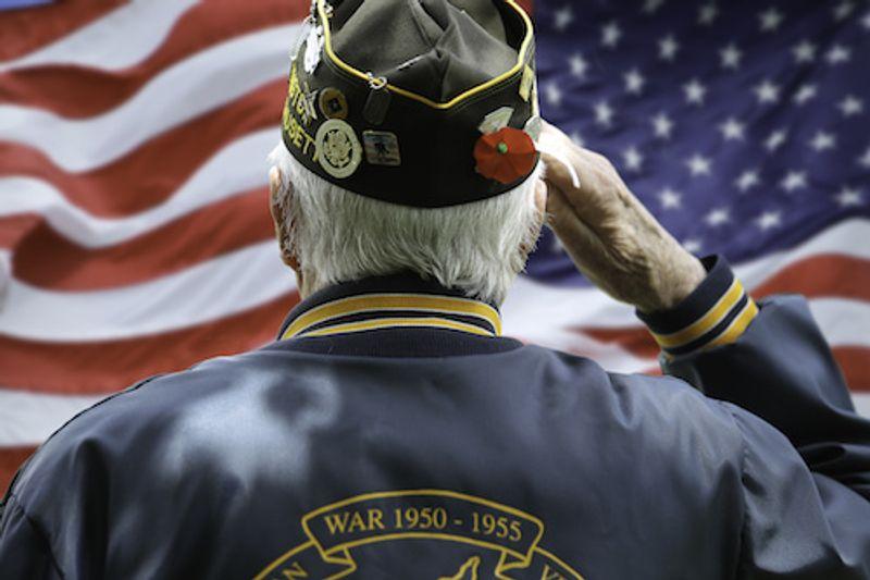 Veteran saluting to American flag