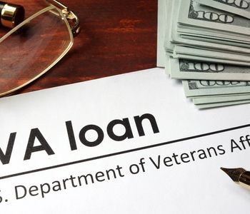 VA loan document with pen and money on the table