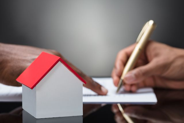 Signing VA Loan documents.