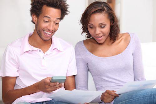 Couple computing VA loan closing costs.