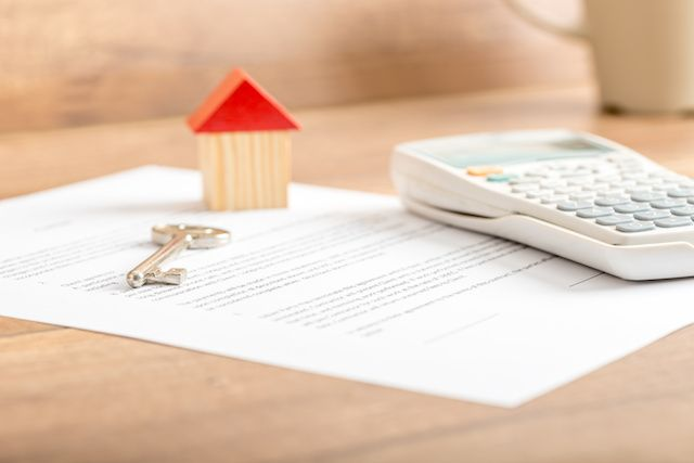 VA Loan documents with key and calculator.