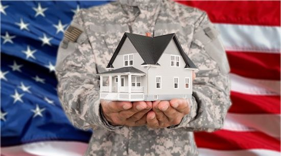 Military holding VA Home Loan concept in hand.