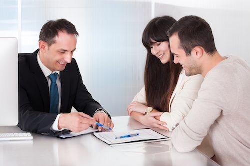 Couple signing VA loan documents.