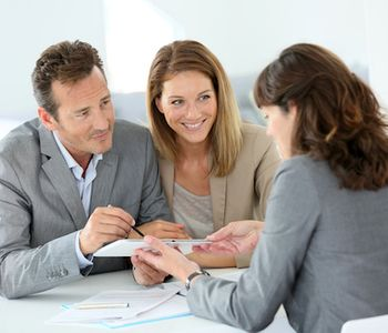 Couple discussing VA Loan with mortgage lender.