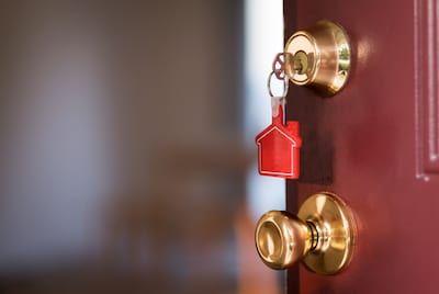 Opening door with house keys.