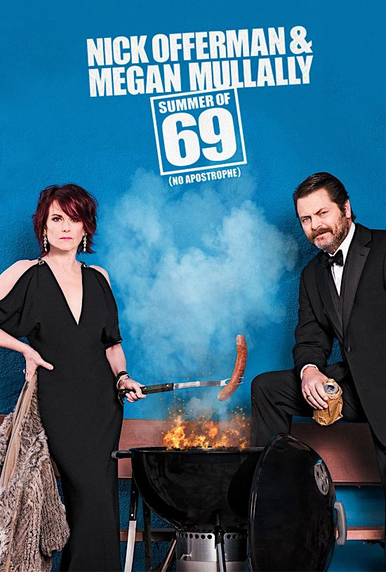 Megan Mullally and Nick Offerman having a barbeque. Megan grills a phallic sausage over flames.