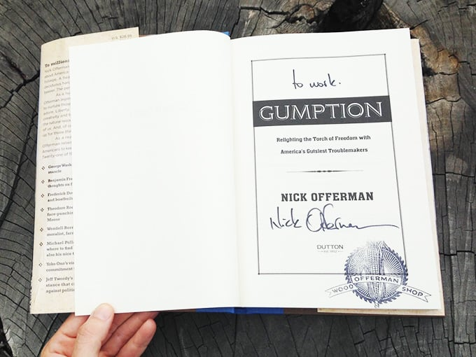 Interior cover page of Gumption with Nick Offerman's inscription: To Work, and autograph. OWS stamp in bottom right corner of page.