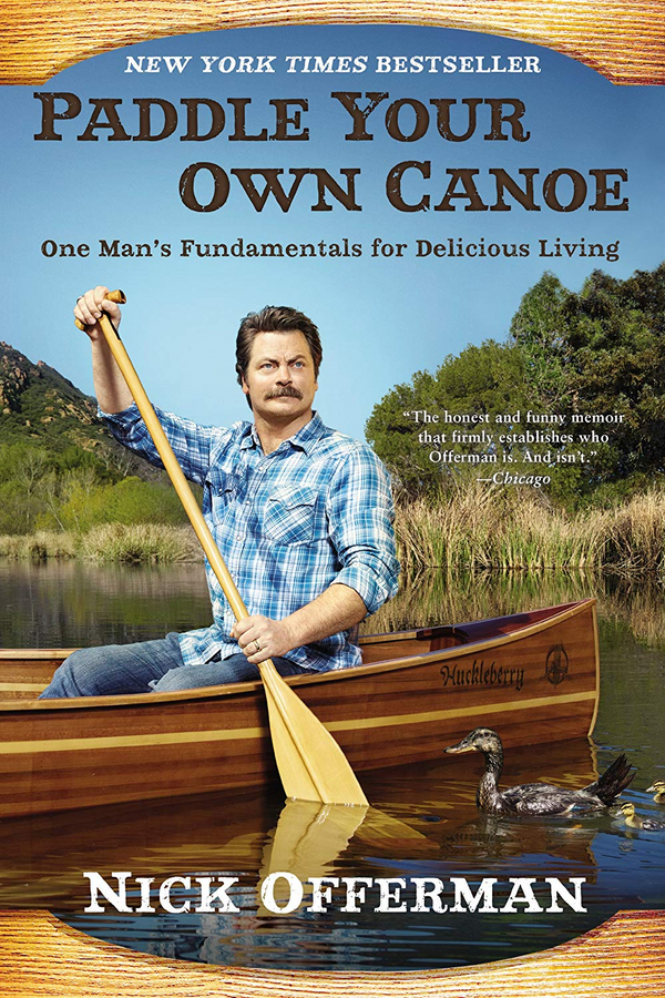 Book cover of Paddle Your Own Canoe featuring Nick Offerman paddling a wooden canoe.