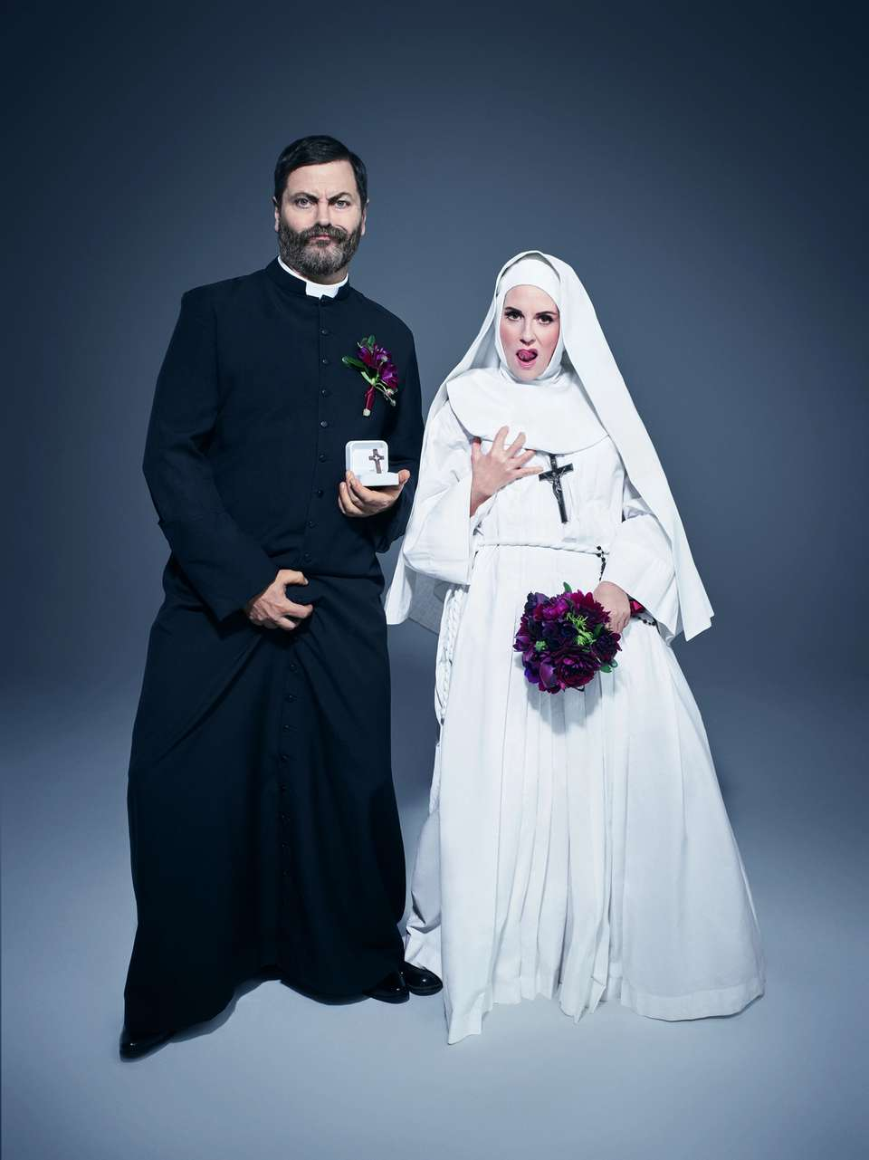 Nick & Megan dressed up as a catholic priest and nun respectively. Both clutching their private parts.