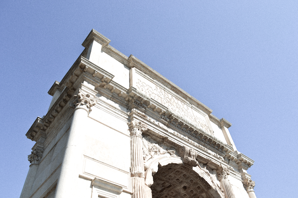 View from below of an Ancient Rome-esque white building.