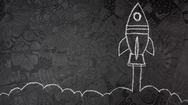 A simple chalk drawing of a rocket taking off.