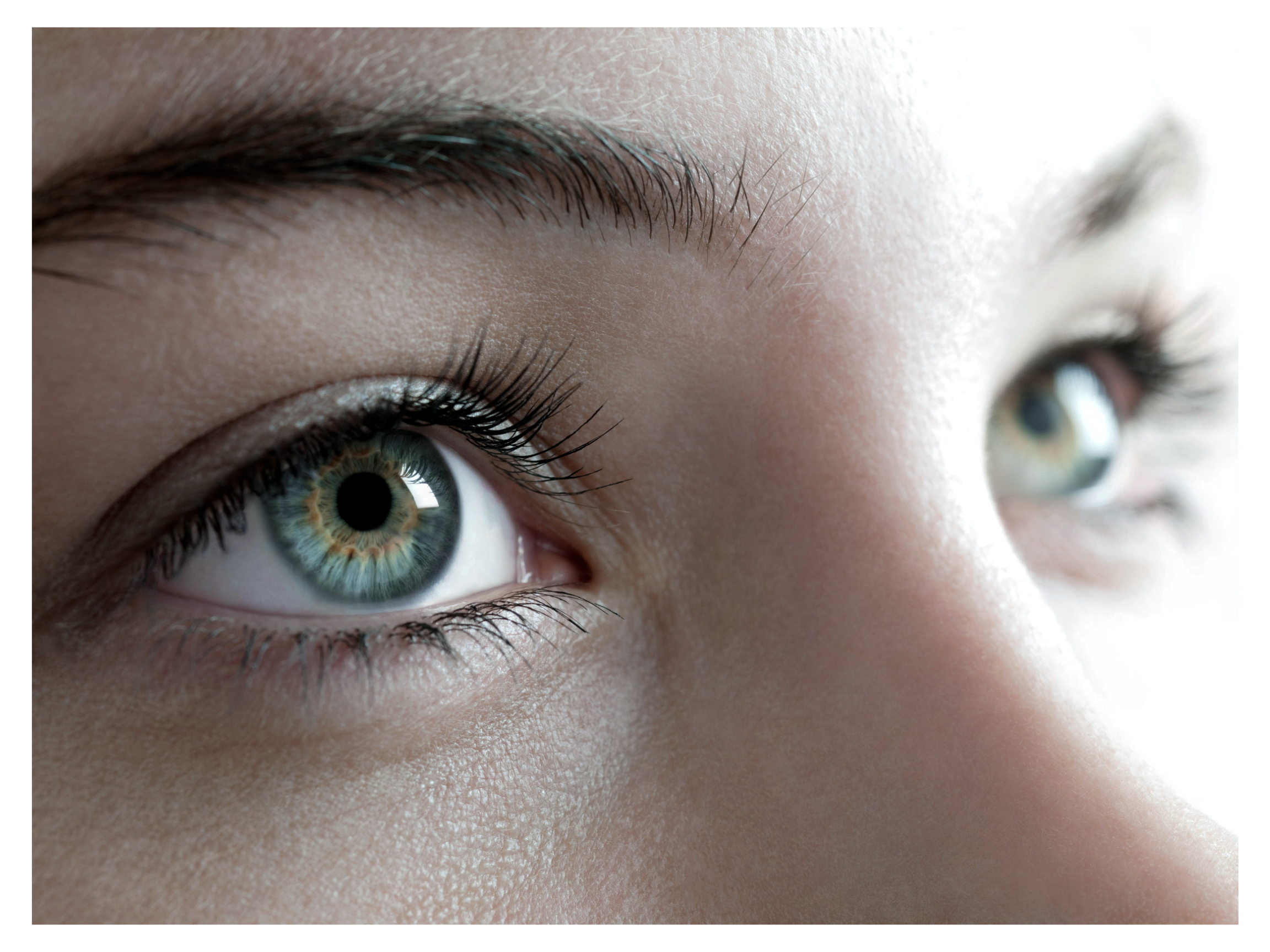 A close up shot of a woman's eyes looking off into the distance.