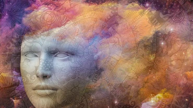 CGI graphic of a statue head with celestial patterns superimposed and a colorful cloud gradient.