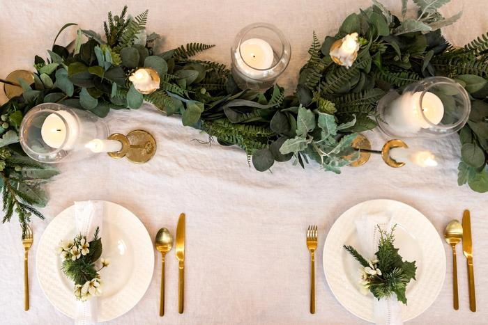Table setting with Christmas wreath