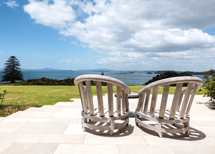 Two chairs on the marble deck of The Landing