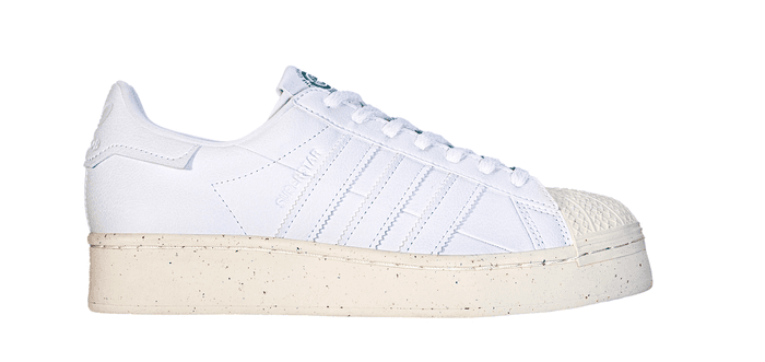 Beige and white Adidas Clean Classics Superstar shoe on a white background