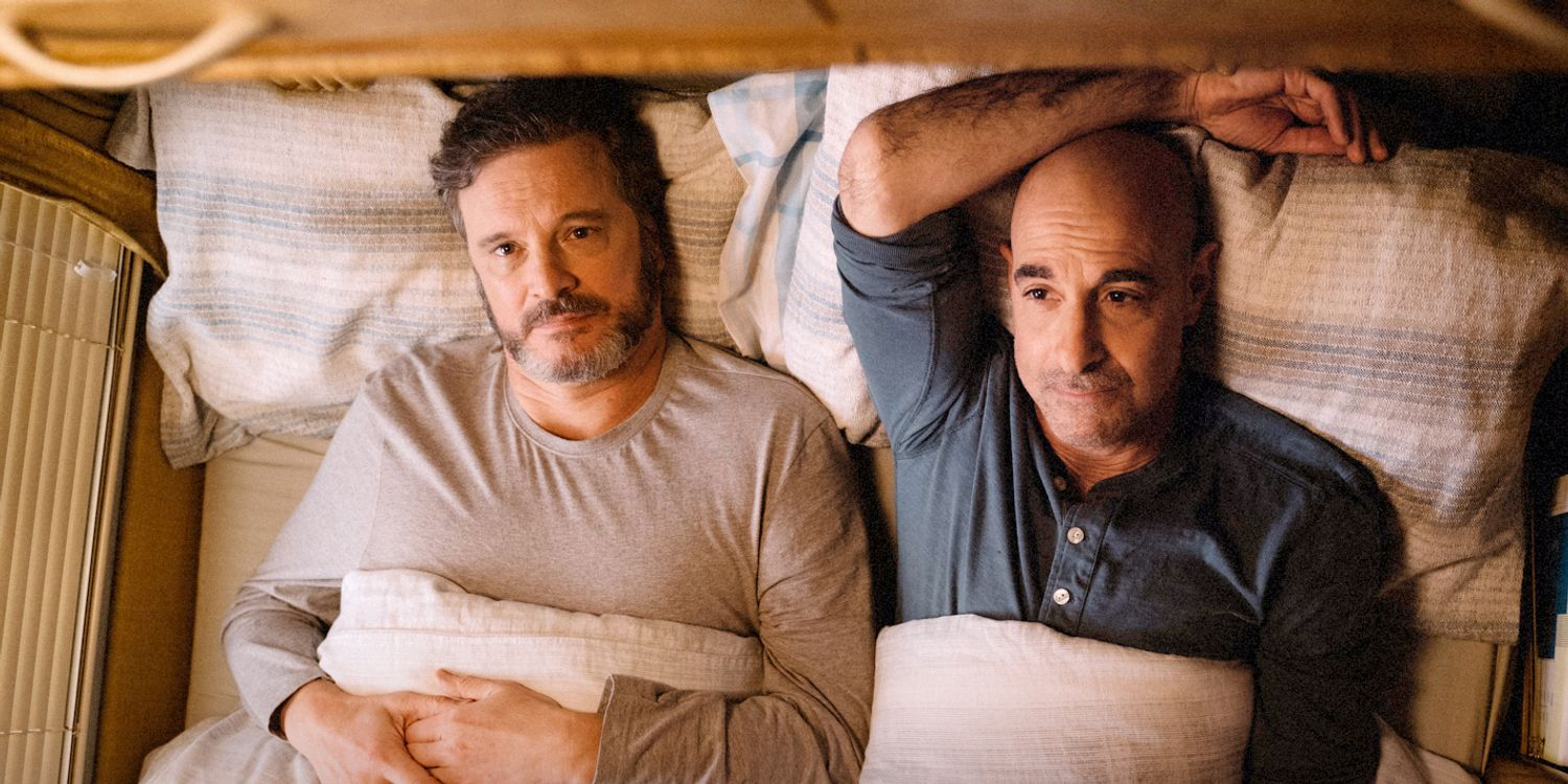 Colin Firth and Stanley Tucci lying in bed together in Supernova