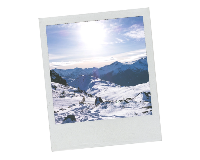 A Polariod of snowy mountains at Whistler, Canada